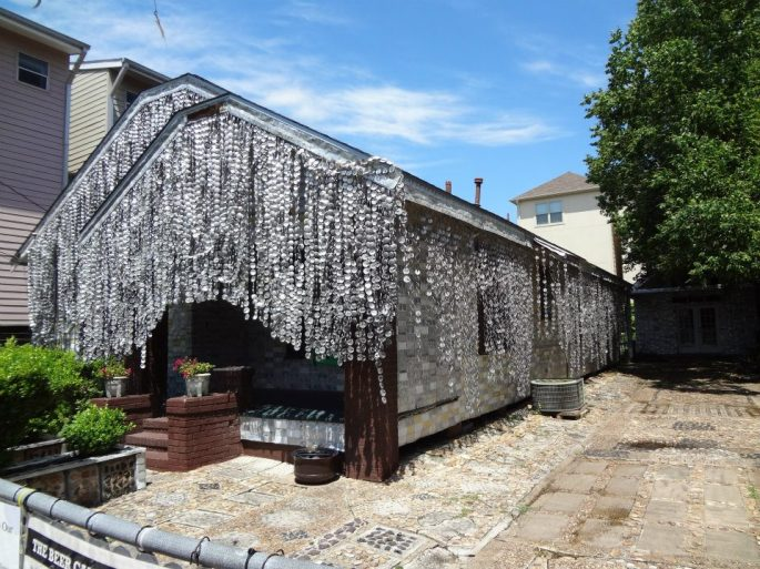 House in Houston covered and decorated in aluminum cans